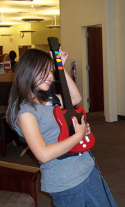 Girl playing Guitar Hero