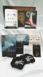Fairy Tales Keyword: Tales Contains: *Cinder by Marissa Meyer signed book *Red Queen by Victoria Aveyard, signed book *Fathomless by Jackson Pearce, book *Frozen by Melissa De La Cruz, book * Alice in Wonderland book necklace *The Lunar Chronicles buttons x4 *The Lunar Chronicles temporary tattoo set *Winter by Marissa Meyer gloves *Marissa Meyer bookplates x3, signed *Fantasy Poster