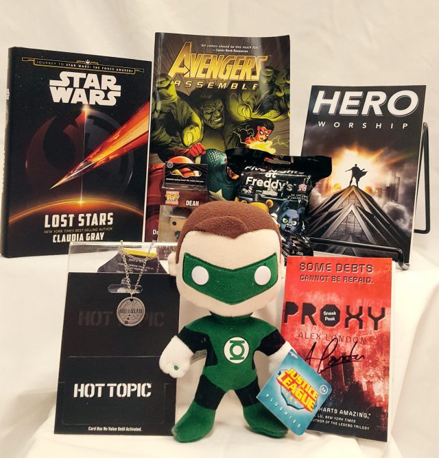 Fandoms Unite Keyword: Fan Contains: *$25 gift certificate to Hot Topic *Lost Stars by Claudia Gray, signed book *Proxy   by Alex London sneak peak, signed *Hero Worship   by Christopher E. Long *Avengers Assemble: Science Bros  , graphic novel *Doctor Who necklace *Dean Winchester (Supernatural) key chain *Five Nights at Freddy's blind box keychain *Green Lantern plushie
